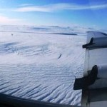 Melting and Refreezing of Deep Greenland Ice Speeds Flow to Sea